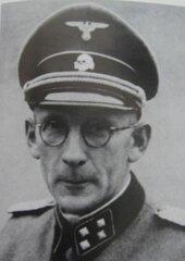 Герой Украины - нацист Евген Побегущий.
